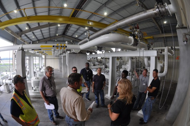 U.S. Army Corps of Engineers project managers and construction representatives, Hawthorne Services, Inc. staff, and installation safety representatives and maintenance contractors perform a final inspection of upgrades on Fuel Island at Hunter Army Airfield Sept. 27, 2016.