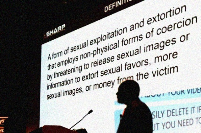 """Special Agent Gabriel Henson, with NCIS, defined """"sextortion"""" as a form of sexual exploitation and extortion that uses non-physical forms of coercion, Sept. 29, during the SHARP Program Improvement Forum, in Alexandria, Va."""