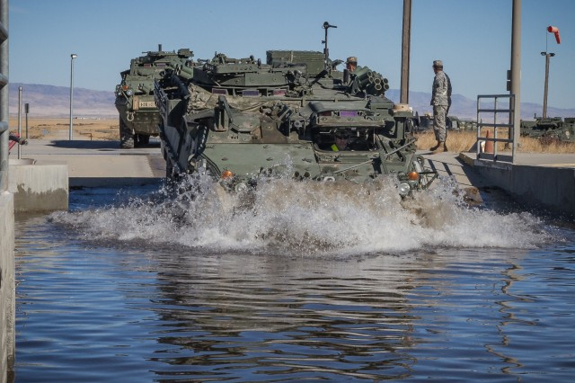 A U.S. Army Soldier assigned to 1st Squadron, 14th Cavalry Regiment, 1st Stryker Brigade Combat Team, 2nd Infantry Division drives a Stryker armored vehicle through a wash rack at Orchard Combat Training Center, Idaho, Sept. 25, 2016. The 200 pieces of equipment that arrived on the train will be used for Raptor Fury, a month-long training exercise to validate the mission readiness of 16th Combat Aviation Brigade with support from nearly 1,500 7th Infantry Division Soldiers.