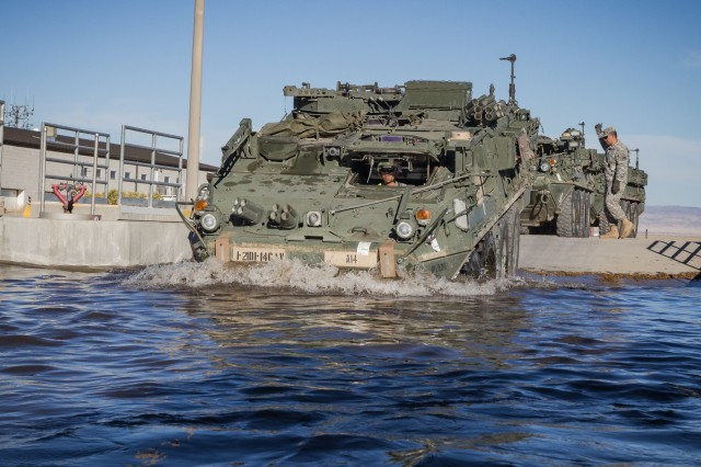 A U.S. Army Soldier assigned to 1st Squadron, 14th Cavalry Regiment, 1st Stryker Brigade Combat Team, 2nd Infantry Division drives a Stryker armored vehicle through a wash rack during rail offload at Orchard Combat Training Center, Idaho, Sept. 25, 2016. The 200 pieces of equipment that arrived on the train will be used for Raptor Fury, a month-long training exercise to validate the mission readiness of 16th Combat Aviation Brigade with support from nearly 1,500 7th Infantry Division Soldiers.