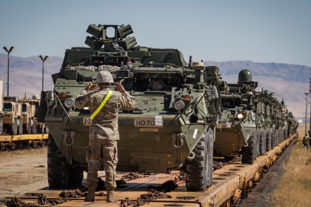 A U.S. Army Soldier assigned to 1st Squadron, 14th Cavalry Regiment, 1st Stryker Brigade Combat Team, 2nd Infantry Division guides a Stryker armored vehicle during rail offload at Orchard Combat Training Center, Idaho, Sept. 25, 2016. The 200 pieces of equipment that arrived on the train will be used for Raptor Fury, a month-long training exercise to validate the mission readiness of 16th Combat Aviation Brigade with support from nearly 1,500 7th Infantry Division Soldiers.