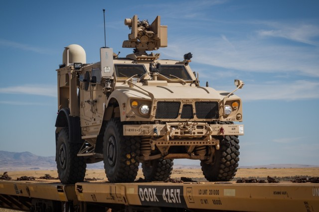 A U.S. Army Soldier assigned to 1st Battalion, 37th Field Artillery Regiment, 2nd Infantry Division Artillery drives a mine-resistant, ambush-protected vehicle off a rail car during rail offload at Orchard Combat Training Center, Idaho, Sept. 25, 2016. The 200 pieces of equipment that arrived on the train will be used for Raptor Fury, a month-long training exercise to validate the mission readiness of 16th Combat Aviation Brigade with support from nearly 1,500 7th Infantry Division Soldiers.