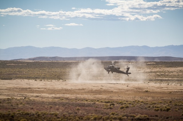 U.S. Army AH-64E Apache helicopter pilots assigned to 1st Battalion, 229th Aviation Regiment, 16th Combat Aviation Brigade, 7th Infantry Division, land at Orchard Combat Training Center, Idaho, Sept. 27, 2016. The aircraft will be part of Raptor Fury, a month-long exercise to validate 16th CAB's mission readiness with the support of nearly 1,500 7th ID Soldiers.