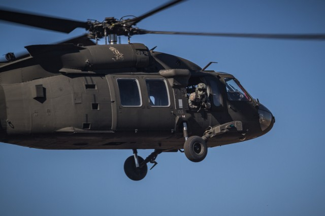 A U.S. Army UH-60M Black Hawk helicopter crew chief assigned to 2nd Battalion, 158th Aviation Regiment, 16th Combat Aviation Brigade, 7th Infantry Division, looks out during landing at Orchard Combat Training Center, Idaho, Sept. 27, 2016. The aircraft will be part of Raptor Fury, a month-long exercise to validate 16th CAB's mission readiness with the support of nearly 1,500 7th ID Soldiers.