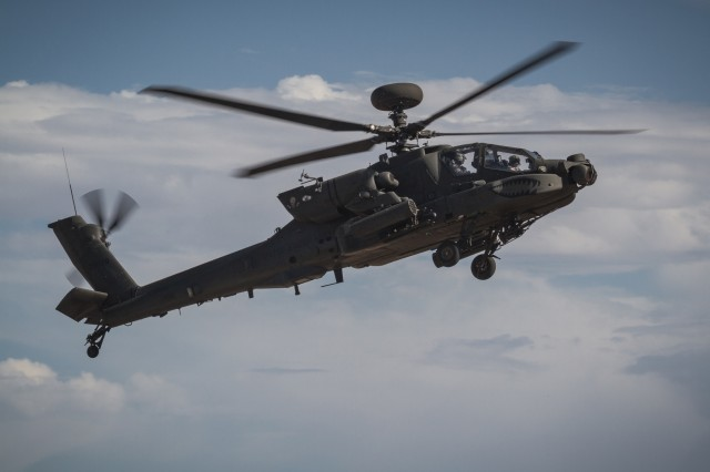 U.S. Army AH-64E Apache helicopter pilots assigned to 1st Battalion, 229th Aviation Regiment, 16th Combat Aviation Brigade, 7th Infantry Division, fly overhead at Orchard Combat Training Center, Idaho, Sept. 29, 2016. The aircraft will be part of Raptor Fury, a month-long exercise to validate 16th CAB's mission readiness with the support of nearly 1,500 7th ID Soldiers.