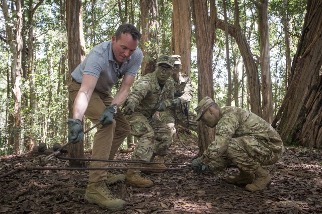 During a tour of the 25th Infantry Division's Lighting Academy jungle training in Hawaii on Tuesday, July 26, 2016, Secretary of the Army Eric K. Fanning tests his skill at pulling up a litter with a rescue dummy.