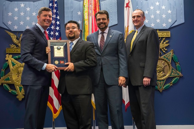 Eric Andreas of the Corpus Christi Army Depot, Texas, second from left, accepts a Lean Six Sigma Excellence Award Project Team Award from Under Secretary of the Army Patrick Murphy for his team's work in leading an improvement project on the AH-64 Apache gun turret flange repair process. With them at the Sept. 14 ceremony at the Pentagon's Hall of Heroes are, third from left, Mark Wagner, CCAD's director of Resource Management, and retired Brig. Gen. Robin Swan, acting director of the Army's Office of Business Transformation.