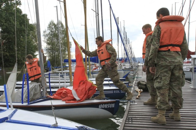 "ŻYWIEC, Poland - Paratroopers assigned to Company D, 2nd Battalion, 503rd Infantry Regiment, 173rd Airborne Brigade, board a sailboat during a trip to Żywiec Lake in Żywiec, Poland, Sep. 29, 2016. The excursion was organized by the Polish 18th Airborne Battalion, 6th Airborne Brigade, and gave the paratroopers a chance to unwind from training. The 173rd Airborne Brigade, based in Vicenza, Italy, is the Army Contingency Response Force in Europe, and is capable of projecting forces to conduct a full range of military operations across the United States European, Central and Africa Command areas of responsibility within 18 hours. The ""Sky Soldiers"" of D Co., 2nd Bn., 503rd Inf. Regt. are in Poland on a training rotation in support of Operation Atlantic Resolve, a U.S. led effort in Eastern Europe that demonstrates U.S. commitment to the collective security of NATO and dedication to enduring peace and stability in the region. (U.S. Army Photo by Sgt. Lauren Harrah/Released)"