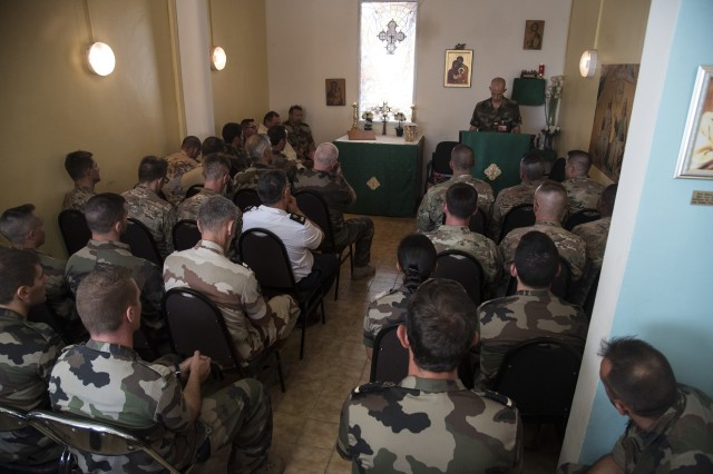 DJIBOUTI- U.S., French and Djiboutian airborne forces attend a ceremony honoring St. Michel's day, the patron saint of paratroopers, Sept. 29, 2016, at the French air base in Djibouti City, Djibouti. The airborne forces began the celebrations with a static line and high altitude low opening jump toward a designated drop zone, followed by a church mass and a ceremony where several U.S. airborne forces were awarded French jump wings. (U.S. Air Force photo by Staff Sgt. Tiffany DeNault)