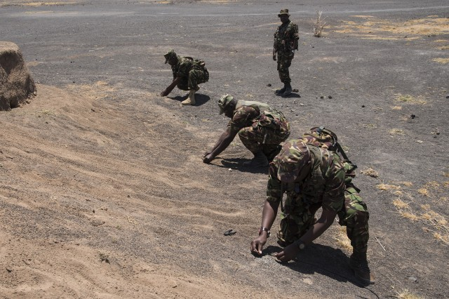 KENYA- Kenya Defense Forces soldiers and officers complete non-electric demolition training during Deliberate Kindle 2016 taught by U.S. Navy Sailors from Task Force Sparta, Sept. 19, at a training center in Kenya. Deliberate Kindle 2016 is taught by U.S. Navy explosive ordnance disposal technicians and a dive independent duty corpsman assigned to Combined Joint Task Force-Horn of Africa. It is a four-week Humanitarian Mine Action course designed to provide training in countering improvised explosive devices and unexploded ordnance, medical, and train-the-trainer skills to approximately 53 KDF soldiers in preparation for future deployments with the African Union Mission in Somalia. (U.S. Air Force photo by Staff Sgt. Tiffany DeNault)