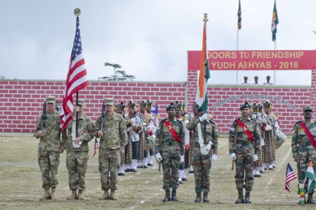 U.S. soldiers (left) with 5-20th Infantry Regiment, 1-2 Stryker Brigade Combat Team, and Indian soldiers with 12 Madras hold their respective country's national flags during the Yudh Abhyas 2016 closing ceremony Sept. 27, 2016, at Chaubattia Military Station, India. Yudh Abhyas is a bilateral training exercise geared toward enhancing cooperation and coordination between the U.S. and Indian armies through training and cultural exchanges.