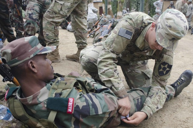 An Indian soldier with 12 Madras, and his U.S. counterpart, practice applying a tourniquet during field trauma management training Sept. 17, 2016, at Chaubattia Military Station, India. The U.S. Soldier was from 5th Battalion, 20th Infantry Regiment, 1-2 Stryker Brigade Combat Team, and was in India for Yudh Abhyas 2016. Yudh Abhyas is a bilateral training exercise geared toward enhancing cooperation and coordination between the two nations through training and cultural exchanges.