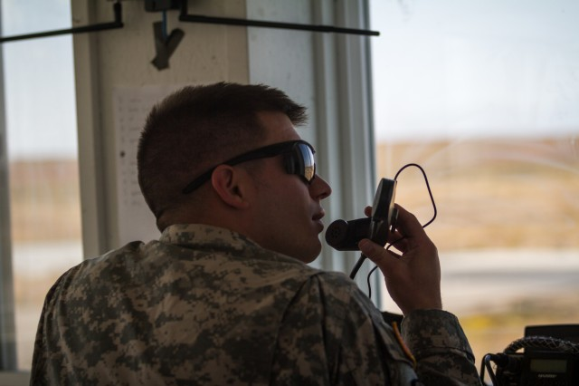 A U.S. Army Soldier assigned to 1st Battalion, 52nd Aviation Regiment, 16th Combat Aviation Brigade communicates with pilots during training at Orchard Combat Training Center, Idaho, Oct. 1, 2016. The Soldier is at OCTC as part of Raptor Fury, a month-long training exercise to validate the mission readiness of 16th CAB with support from nearly 1,500 7th ID Soldiers.