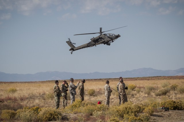 U.S. Army AH-64E Apache helicopter pilots assigned to 16th Combat Aviation Brigade, 7th Infantry Division land for refueling during gunnery at Orchard Combat Training Center, Idaho, Oct. 2, 2016. The Apache is being used as part of Raptor Fury, a month-long training exercise to validate the mission readiness of 16th CAB with support from nearly 1,500 7th ID Soldiers.