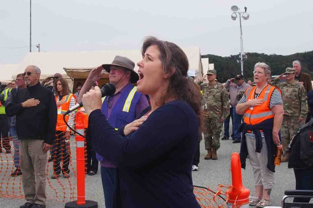 Julie Posey of Salinas sings the national anthem at the official opening of the Veteran's Transition Center Stand Down Aug. 19.