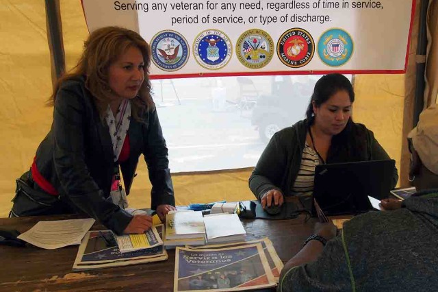 Lorena Vazquez (left) and Stephanie Dieguez of the Santa Cruz County Veteran's Services Office assist a veteran at the Veteran's Transition Center Stand Down Aug. 19.