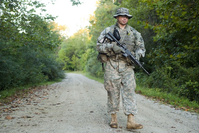 Sgt. 1st Class David Renteria, communications noncommissioned officer in charge for 1st Battalion, 335th Brigade Engineer Battalion, 157th Infantry Brigade, sets off down the road for the first road march of the first-quarter 2017 First Army Division East Best Warrior Competition at Camp Atterbury, Ind., Sept. 27, 2016. Renteria went on to win the three-day competition. (U.S. Army photo by Staff Sgt. Darron Salzer, First Army Division East Public Affairs)
