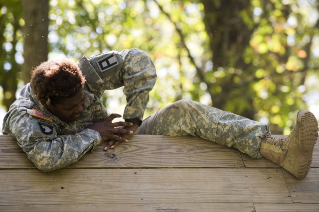Sgt. 1st Class Joi Friend, a Chemical, Biological, Radiological and Nuclear specialist with 1st Squadron, 409th Brigade Engineer Battalion, 4th Cavalry Brigade, climbs over a wall at the confidence course during the first-quarter 2017 First Army Division East Best Warrior Competition at Camp Atterbury, Ind., Sept. 27, 2016. Division East plans to hold three more competitions this fiscal year. (U.S. Army photo by Staff Sgt. Darron Salzer, First Army Division East Public Affairs)