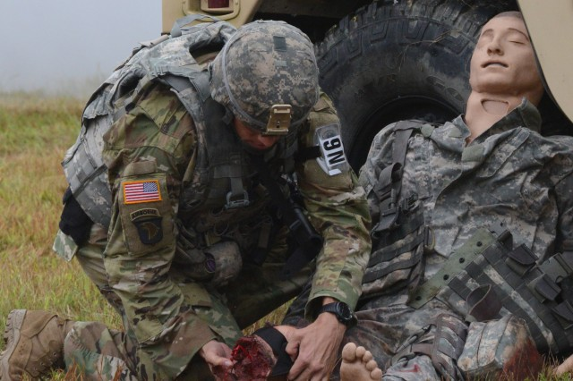 Sgt. 1st Class Joshua Moeller provides medial aid to a field dummy during the Best Warrior Competition at Fort A.P. Hill, Va., Sept. 28, 2016.
