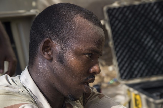 A Djibouti Armed Forces (FAD) service member sweats from the heat while setting up an Africa Data Sharing Network (ADSN) satellite Sept. 28, 2016, at FAD Headquarters in Djibouti. While conducting the best practices training, the U.S. Army, assigned to Combined Joint Task-Horn of Africa, also held an ADSN validation with the FAD soldiers to prepare them to deploy to Somalia. The ADSN provides network and Voice over Internet Protocol capabilities between the several African countries participating in Africa Union Mission in Somalia. (U.S. Air Force photo by Staff Sgt. Eric Summers Jr.)