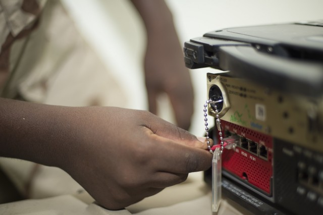 A Djibouti Armed Forces (FAD) service member connects a cord to run between an Africa Data Sharing Network (ADSN) modem and laptop Sept. 29, 2016, at FAD Headquarters in Djibouti. While conducting the best practices training, the U.S. Army, assigned to Combined Joint Task-Horn of Africa, also held an ADSN validation with the FAD soldiers to prepare them to deploy to Somalia. The ADSN provides network and Voice over Internet Protocol capabilities between the several African countries participating in Africa Union Mission in Somalia. (U.S. Air Force photo by Staff Sgt. Eric Summers Jr.)