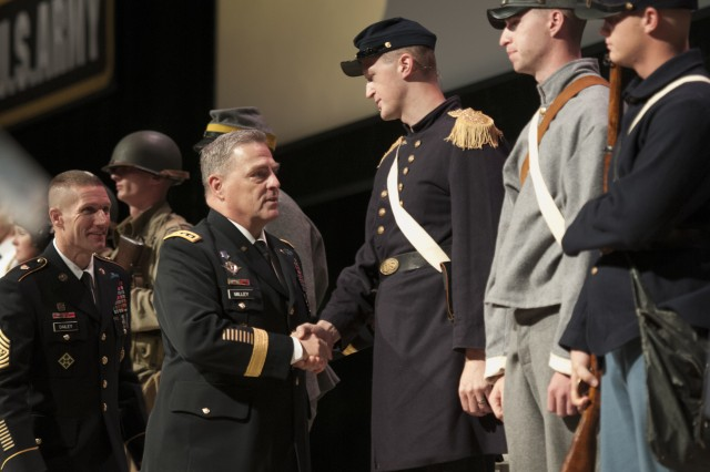 Army Chief of Staff Gen. Mark A. Milley and Sgt.Maj. of the Army Daniel A. Dailey shake hands with Soldiers dressed in uniforms of previous conflicts during the opening ceremony of the Association of the U.S. Army Annual Meeting and Exposition in Washington, D.C., Oct. 3, 2016.