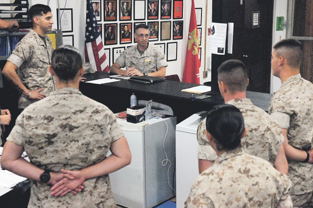 Navy Chaplain (Lt.) Jeremy Bennett, center, gives Marines awaiting training an overview of religious and counseling support. The chaplain and his assistant, Navy Petty Officer 3rd Class Chad Welke are responsible for more than 5,000 Marine Corps, Navy and Air Force students who train at Fort Leonard Wood annually.