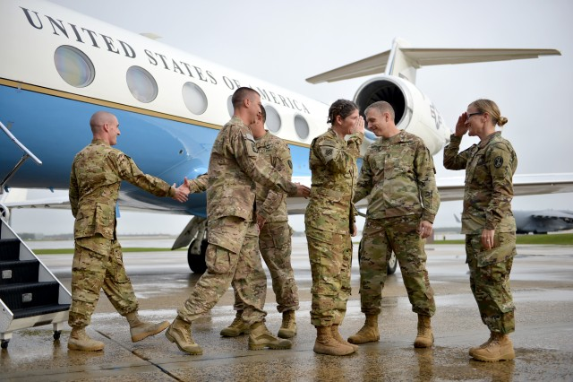 Soldiers from U.S. Army Priority Air Transport Command's (USAPAT) Pacific Flight Detachment (PFD), are greeted by members of the command team as they exit the aircraft on Joint Base Andrews, Md., Oct. 1, 2016, after a four-month deployment to Afghanistan.