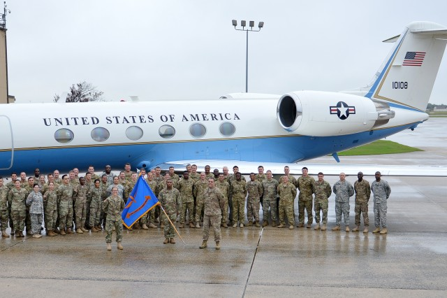 Members of the U.S. Army Priority Air Transport Command, U.S. Army Air Operations Group and the U.S. Army Military District of Washington, stand for a photo before their homecoming celebration at Joint Base Andrews, Md., Oct. 1, 2016.