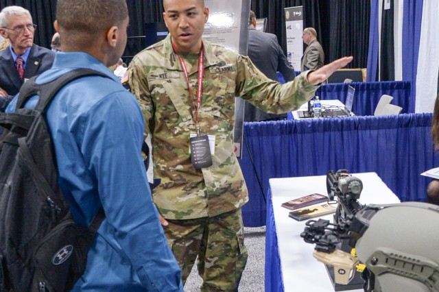 Maj. Michael Kee, assigned to the U.S. Army Communications-Electronics Research, Development and Engineering Center, displays night-vision capabilities Oct. 3 at AUSA 2016 in Washington.