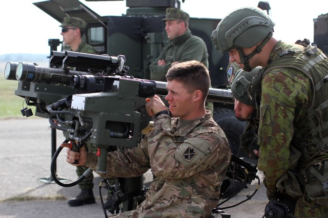 Airmen from the Lithuania Air Force Air Defense Battalion show 10th AAMDC Soldier how to operate their stinger missile system during a static weapon display during Tobruq Legacy 16. Tobruq Legacy is an annual multinational air defense exercise designed to increase the interoperability of allied nations in Europe both tactically and technically.