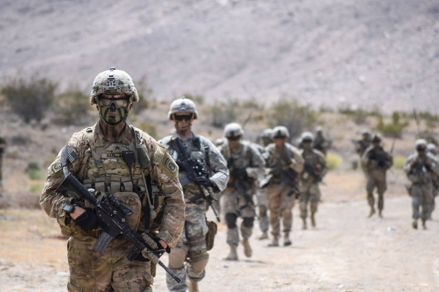 U.S. Army paratroopers, assigned to 3rd Brigade Combat Team, 82nd Airborne Division, hike up a mountain a company combined arms live fire exercise at the Operations Group, National Training Center at Fort Irwin, Calif., April 27, 2016.