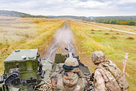 A Slovakian soldier shoots an M2 .50 Caliber machine gun mounted on an Outlaw Troop, 4th Squadron, 2nd Cavalry Regiment Stryker, an eight wheeled armored fighting vehicle, during Slovak Shield 2016 live-fire training, Oct. 4, 2016, at a multi-purpose range in Military Training Area Lest, Slovak Republic. Understanding weapons of NATO allies is vital to the interoperability of U.S. and allied troops during training or a NATO mission.