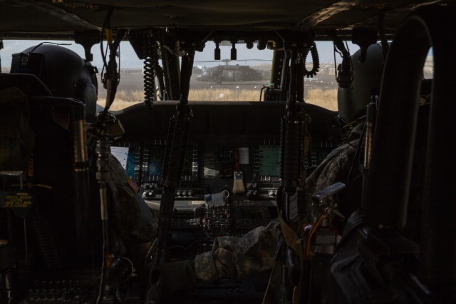 U.S. Army UH-60 Black Hawk helicopter pilots assigned to 2-158th Assault Helicopter Battalion, 16th Combat Aviation Brigade, 7th Infantry Division fly towards a mountain range at Orchard Combat Training Center, Idaho, Oct. 5, 2016. The pilots were preparing to conduct High Altitude Mountain Environmental Training in the nearby Owyhee Mountains to hone skills needed for missions around the world as part of Raptor Fury, a major training exercise bringing together over 1,000 7th ID Soldiers to validate 16th CAB's mission readiness.