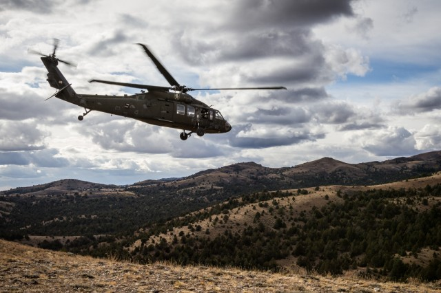 U.S. Army UH-60 Black Hawk helicopter pilots assigned to 2-158th Assault Helicopter Battalion, 16th Combat Aviation Brigade, 7th Infantry Division depart from an 8,000-foot peak at Owyhee Mountains, Idaho, Oct. 5, 2016. The pilots were conducting High Altitude Mountain Environmental Training to hone skills needed for missions around the world as part of Raptor Fury, a major training exercise bringing together over 1,000 7th ID Soldiers to validate 16th CAB's mission readiness.