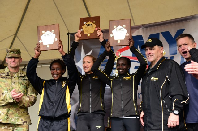 Top three female finishers in Army Ten-Miler pose with Army leaders