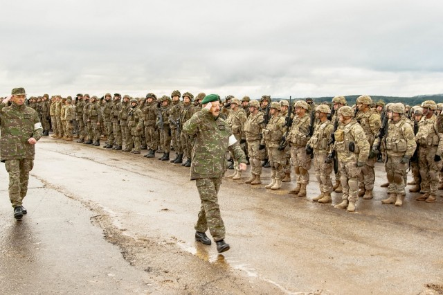 Lt. General Pavel Macko, 1st Deputy Chief of the General Staff of the Armed Forces of the Slovak Republic, walks the formation of troops while saluting to begin the Slovak Shield 2016 opening ceremony Oct. 6, 2016 at Military Training Area Lest, Slovak Republic.