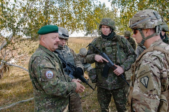 Lt. General Pavel Macko, exercise director and 1st Deputy Chief of the General Staff of the Armed Forces of the Slovak Republic, discusses combined engineer cohesion with Lt. Col John E. Pitt, Tactical Operations Center officer-in-charge, Indiana National Guard, while visiting engineer training during Slovak Shield 2016 Oct. 9, 2016 at Military Training Area Lest, Slovak Rep.