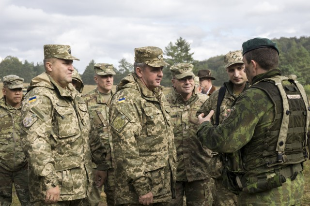 Col. Mindaugas Steponavicius (right) with Lithuania's Iron Wolf Brigade, briefs Gen. Viktor Muzhenko, the chief of general staff, Commander in Chief of Armed Forces for Ukraine; Lt. Gen. Ben Hodges, commanding general of U.S. Army Europe; Brig. Gen. Tony Aguto, commander of 7th Army Training Command; and other members of the Ukraine Ministry of Defense during a visit to the tactical operations center in the Hohenfels Training Area, during Allied Spirit V Oct. 9.