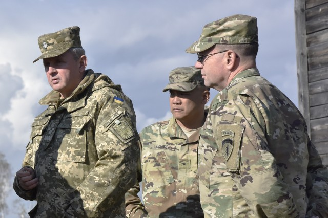 (From left) Gen. Viktor Muzhenko, the chief of general staff, Commander in Chief of Armed Forces for Ukraine; Brig. Gen. Tony Aguto, commander of 7th Army Training Command; and Lt. Gen. Ben Hodges, the commander of U.S. Army Europe; listen to a capabilities brief on Range 118 in the Grafenwoehr Training Area, Oct. 10.