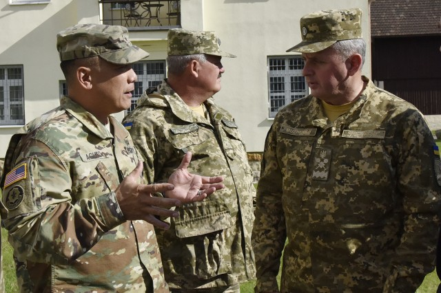 Brig. Gen. Tony Aguto (left), commander of 7th Army Training Command, speaks to Gen. Viktor Muzhenko (right), the chief of general staff, Commander in Chief of Armed Forces for Ukraine, at the 7ATC headquarters on Tower Barracks, Grafenwoehr, Germany, Oct. 10.