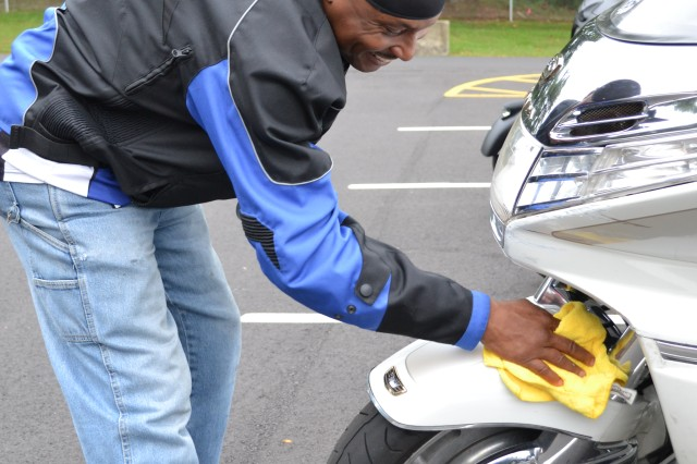 Master Sgt. Gregory Moody, contracting officer representative for the 80th Training Command (TASS), doesn't miss a spot cleaning his motorcycle at the command's Family Programs Center in Richmond, Va., as he prepares for the motorcycle mentorship ride in honor of Sgt. Scott McGinnis on Oct. 6, 2016. McGinnis, 22, died in a motorcycle accident July 4, 2016 in Centre, Ala., where he was struck by another vehicle.