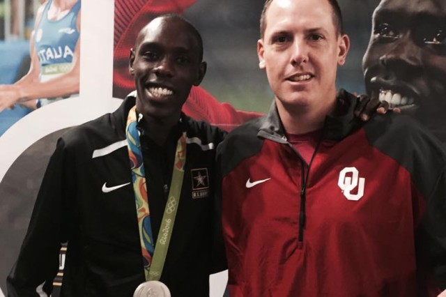 Sgt. 1st Class Stephen Love, assistant inspector general, First U.S. Army, meets gold metal Olympian Spec. Paul Chelimo, U.S. Army World Class Athlete Program, Fort Carson, Colorado, before they run the Army Ten-Miler race in Washington, D.C., Oct. 9.