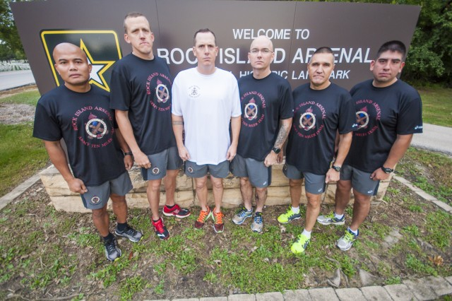 Members of the 2016 Rock Island Arsenal Ten-Miler Team gather early in the morning for a team meeting at Rock Island Arsenal, Oct. 5. The team members are: First Sgt. Efren Delpilar (left), first sergeant, Headquarters and Headquarters Company, U.S. Army Sustainment Command; Maj. Shawn Muder, executive officer, Distribution Management Center, ASC; Sgt. 1st. Class Stephen Love, assistant inspector general, First U.S. Army; Capt. Joshua Weisman, contracting specialist, U.S. Army Contracting Command; Sgt. Maj. Jurgen Williams, Support Operation, ASC; Capt. Adrian Castillo, operations plans officer, ASC.