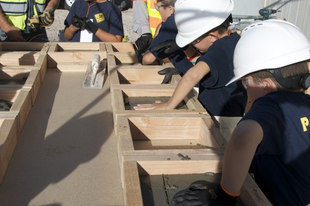 Members of the Fort Irwin WEBELOS Cub Scout pack 67 recently visited the site of the new Weed Army Community Hospital, still under construction, to work on a badge and learn about what is involved in building such a large structure.