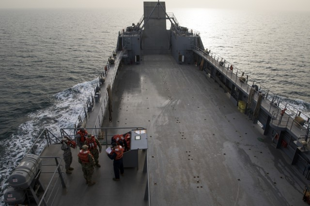 The 411th Transportation Detachment Soldiers aboard the MG Charles P. Gross (Logistics Support Vessel-5) practice their abandon ship drills during a range exercise in the Arabian Gulf, October 3, 2016. The ship, a logistics asset for U.S. Army Central, is responsible for transporting massive tonnage - up to 900 tons - on its deck anywhere in the world.