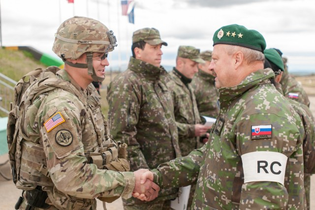 Lt. General Pavel Macko, exercise director and 1st Deputy Chief of the General Staff of the Armed Forces of the Slovak Republic U.S. Army Soldiers, Armed Forces of the Slovak Republic, congratulates Capt. Matthew Maxcy, team outlaw and Outlaw Troop commander, 4th Cavalry Squadron, 2nd Cavalry Regiment, during the closing ceremony of Slovak Shield 2016 Oct. 12, 2016 at Military Training Area Lest, Slovak Republic. U.S. Soldiers participated in Slovak Shield as a part of Atlantic Resolve, a U.S.-led effort in Eastern Europe that demonstrates the U.S. commitment to the collective security of NATO and enduring peace and stability in the region..