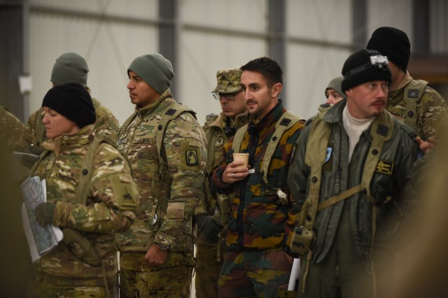 Soldiers from 12th Combat Aviation Brigade, the 1st Armored Division CAB and Belgium conduct a mission brief for a potential air assault mission during exercise Allied Spirit V, near Hohenfels, Germany, Oct. 12, 2016.  Allied Spirit V is a force on force exercise involving 1,065 participants from the NATO countries of Belgium, Canada, Czech Republic, Germany, Italy, Lithuania and the United Kingdom.