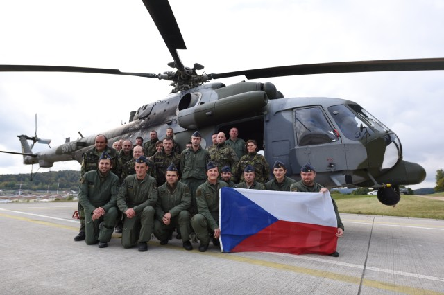 "Czech Air Force Soldiers from the 221st Squadron and 222nd Squadron from the 22nd Helicopter Air Base ""Biskajska,"" pose for a picture with their MI-171  during exercise Allied Spirit V, near Hohenfels, Germany, Oct. 12, 2016.  Allied Spirit V is a force on force exercise involving 1,065 participants from the NATO countries of Belgium, Canada, Czech Republic, Germany, Italy, Lithuania and the United Kingdom."