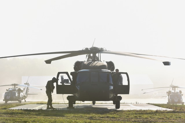 A crew chief and pilot from 3rd Bn., 501st Avn. Regt., 1AD CAB conduct pre-flight checks for a UH-60 Black Hawk on a foggy morning during Exercise Allied Spirit V, near Hohenfels, Germany, Oct. 12, 2016.  Allied Spirit V is a force on force exercise involving 1,065 participants from the NATO countries of Belgium, Canada, Czech Republic, Germany, Italy, Lithuania and the United Kingdom.